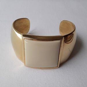 Avon golden/ ivory cuff bracelet